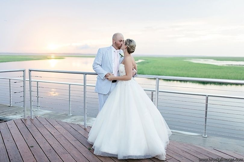 Newlyweds kissing over the Intracoastal waterway