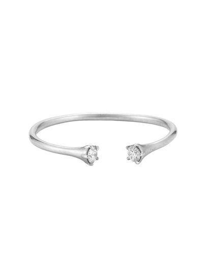 This dainty stacking ring from jewelry designer Jade Trau is composed of 14 karat white gold with an...