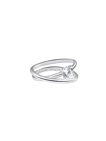 This stunning ring from Maison Margiela has a beautiful round brilliant diamond that has a carat...