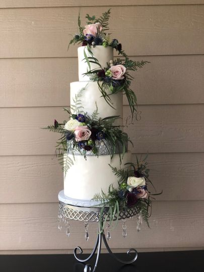 White and silver floral cake