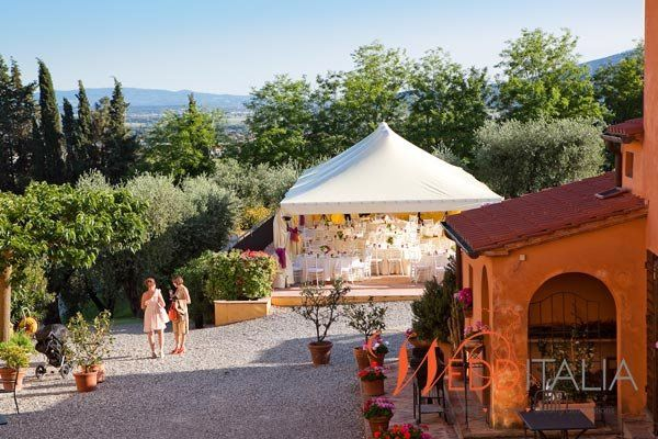 An open-air wedding reception in Tuscany.