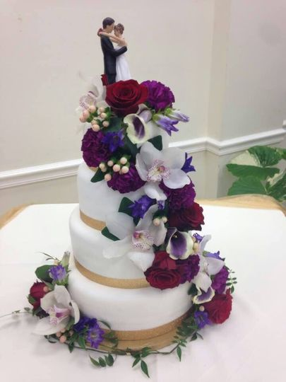 white wedding fond with purple flowers