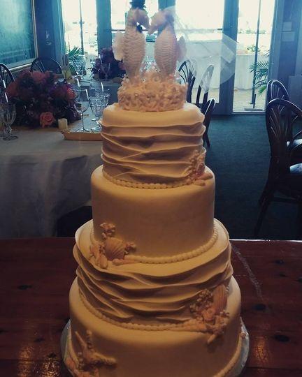 tier seashorse wave white cake