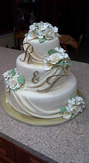 ivory fondant draped wedding cake