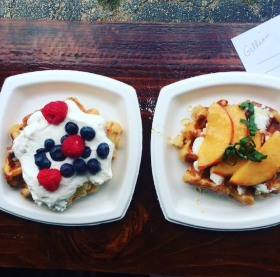 Left: Liège waffle with Lemon Curd, House-Made Whipped Cream, Strawberries, and Blueberries.  Right:...