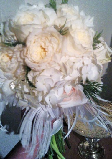 This winder chic wedding was created with white roses, white hydrangea, winter greens, crystal...
