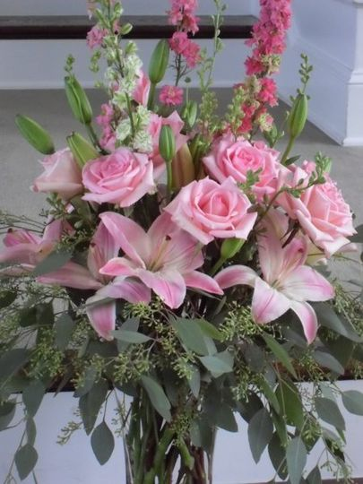 Vase of pinks... lilies, larkspur, roses, seeded eucalyptus