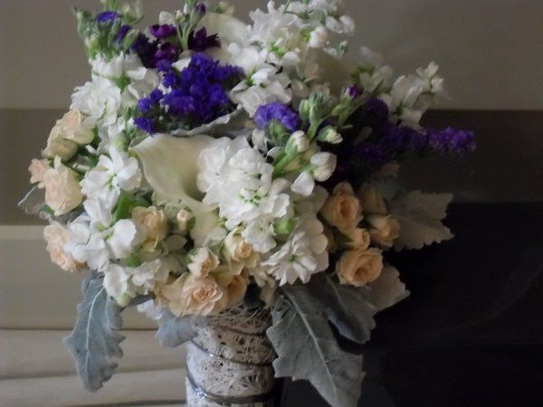 Hillary's bouquet of stock, the statice she loves, mini-callas, mini roses, Dusty Miller.