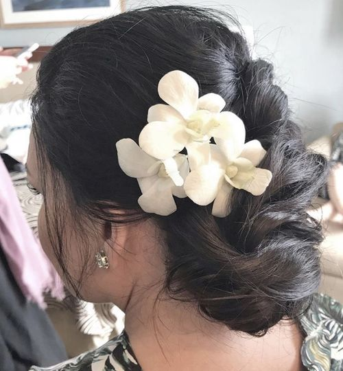 Messy updo with orchid flowers