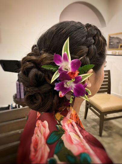 Big low updo with orchids