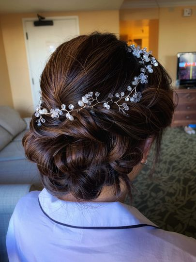 Low updo with crown accessory