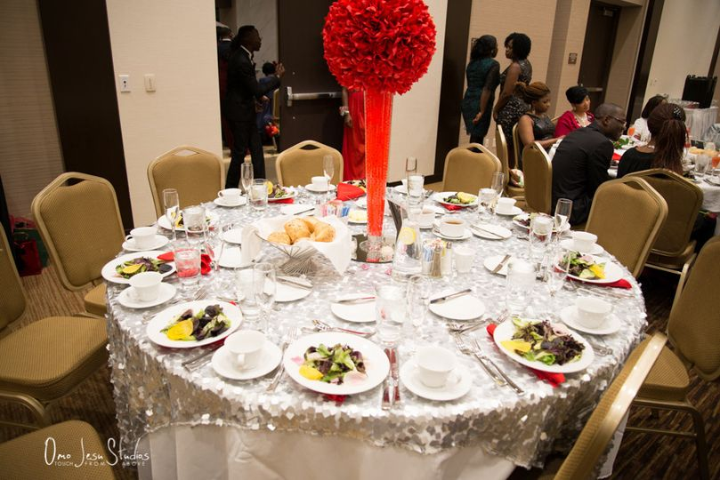 Table setup with red centerpiece
