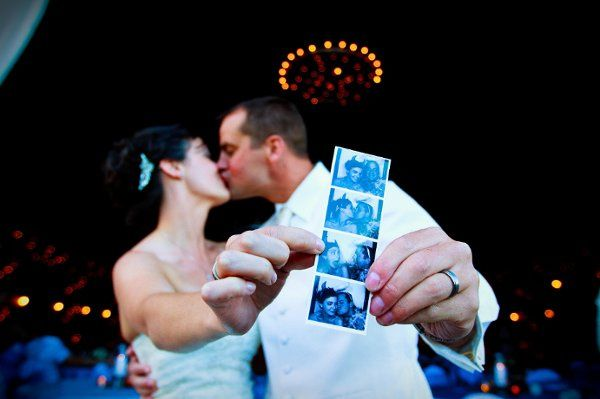 Newlyweds kissing and holding their film strip