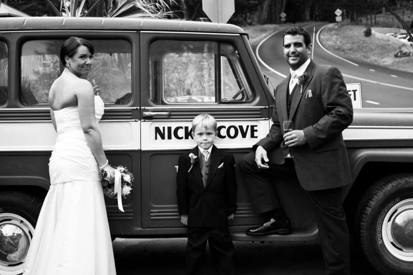 Newlyweds and the little boy by the car