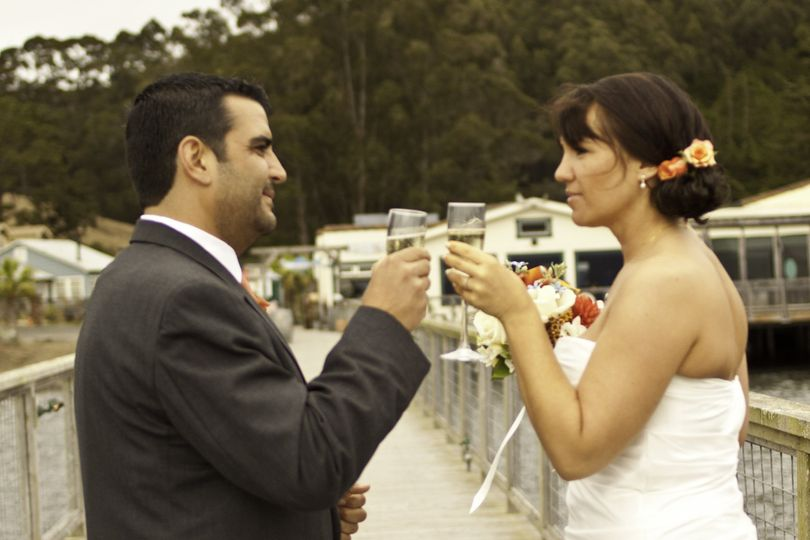 Groom and bride toasting