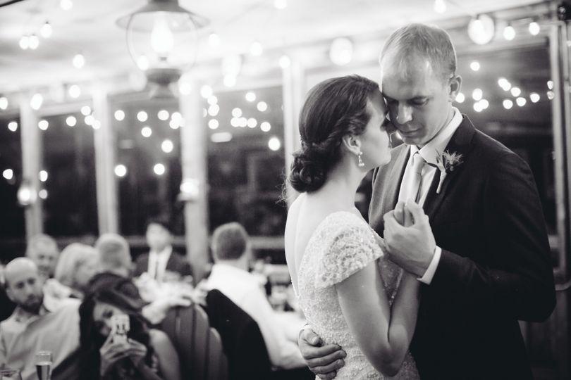 Groom holding his bride