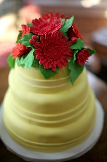 This cake was a carrot cake with a cream cheese frosting.  It was covered in a buttery yellow...