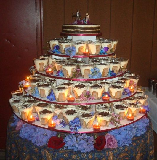 This cake was composed of individual tiramisu cups layered on several tiers.  Each tier was then...