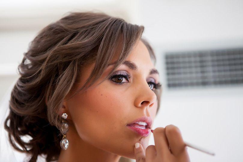 Applying lip makeup