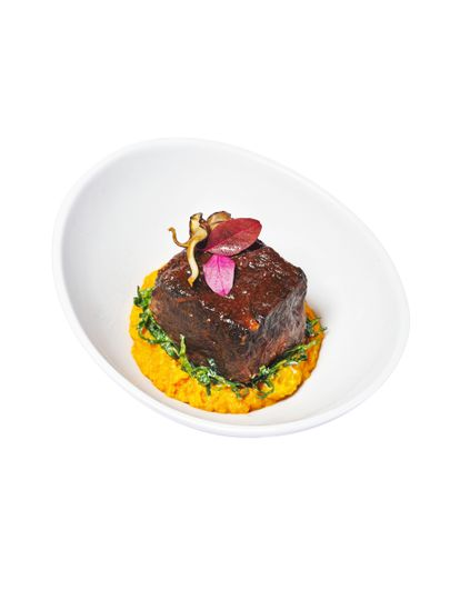 Braised short rib + saffron risotto + shaved black kale