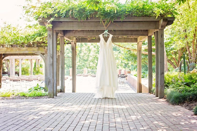 Gown hangs on a pergola - Lindsey Gettig Photography