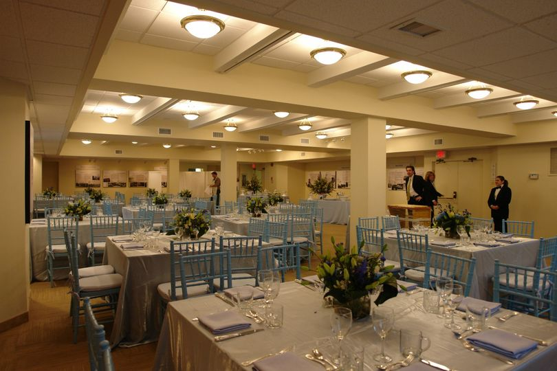 social hall setup fancy white tables and chairs