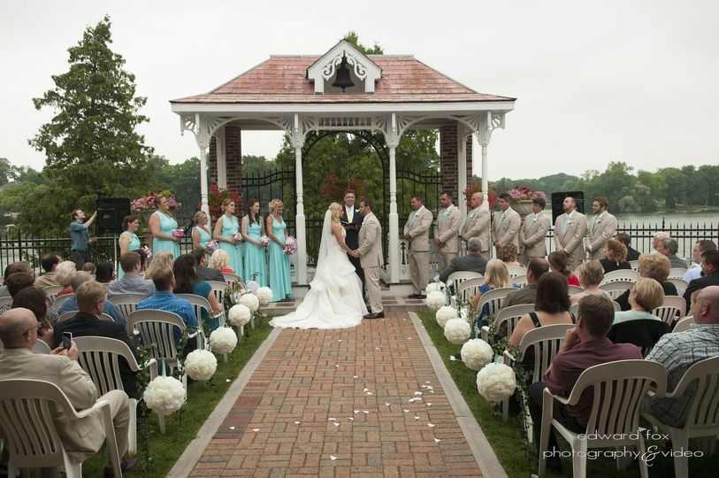 Wedding ceremony with guests, bridesmaid, and groomsmen
