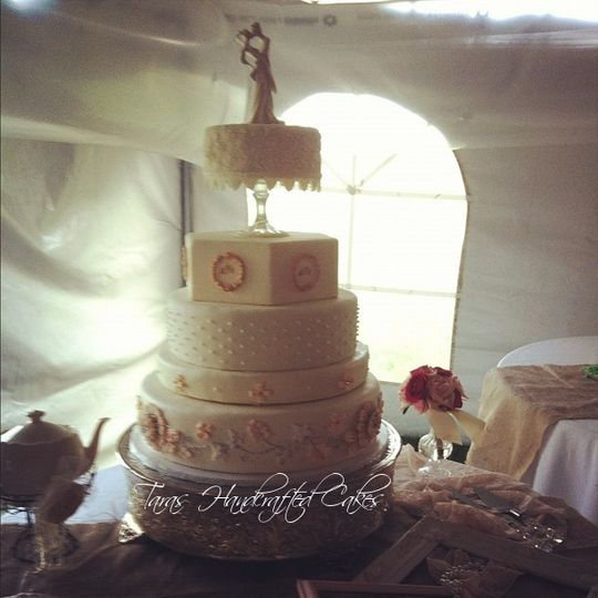 Vintage style wedding cake using details from wedding dress and invitations.  Royal icing piped lace...