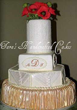 Pleated gold fondant bottom tier, corset laced fondant octagon, royal icing piped monograms, crystal...