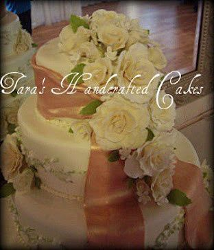 Gum paste roses and leaves in several sizes and gum paste stephanotis with edible pearl centers....