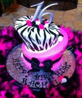 Topsy turvey birthday cake with fondant ribbon roses, fondant bows and zebra print.