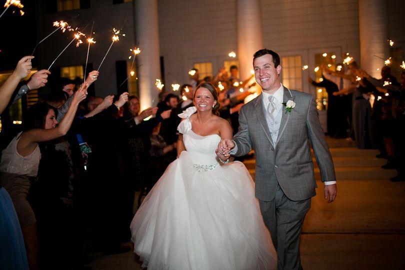 Wedding sparkler exit at The Milestone in Denton, TX. Denton wedding photography, bride and groom...