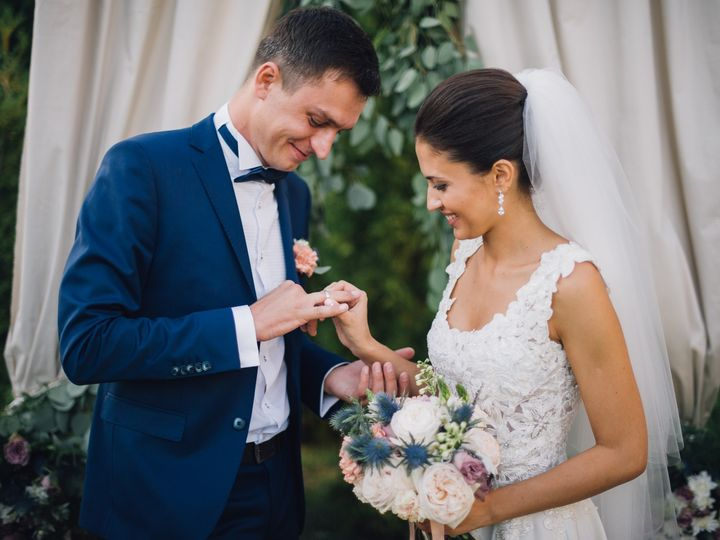 Tmx Couple In Wedding Attire Exchange Rings With A Bouquet Of Flowers And Greenery In The Garden With Arch On Background The Bride And Groom 51 1873283 1567116420 Raleigh, NC wedding videography