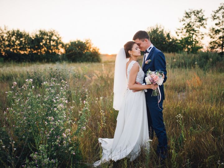 Tmx Couple In Wedding Attire With A Bouquet Of Flowers And Greenery Is In The Hands Against The Backdrop Of The Field At Sunset The Bride And G 51 1873283 1570460152 Raleigh, NC wedding videography