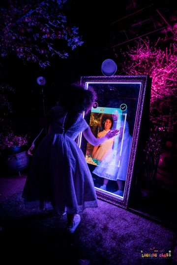 Woman with mirror booth