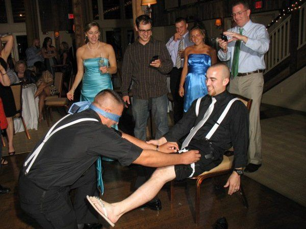 Having some fun playing a trick on the gentleman who caught the garter.