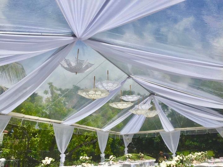 Clear tent with white drapes