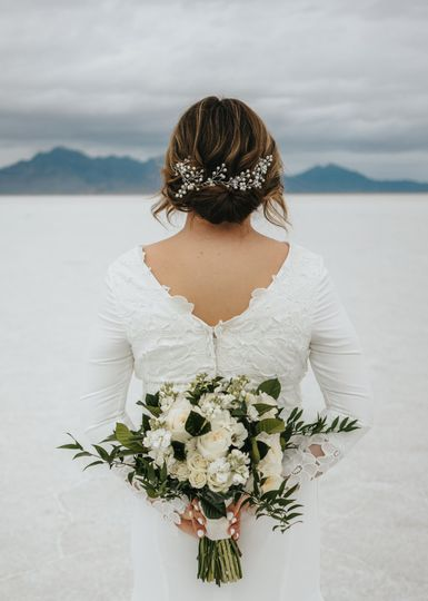 A loose & low bridal updo