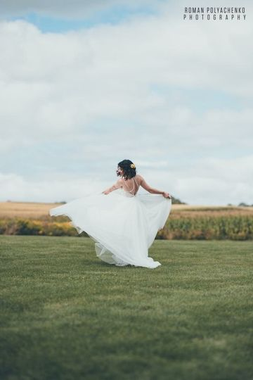 Bride twirling around in her dress
