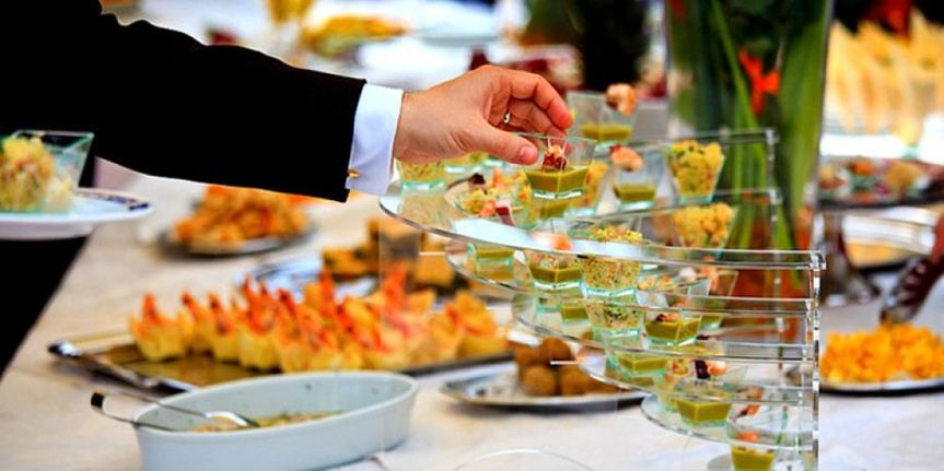 catering company photo holding catering pieces