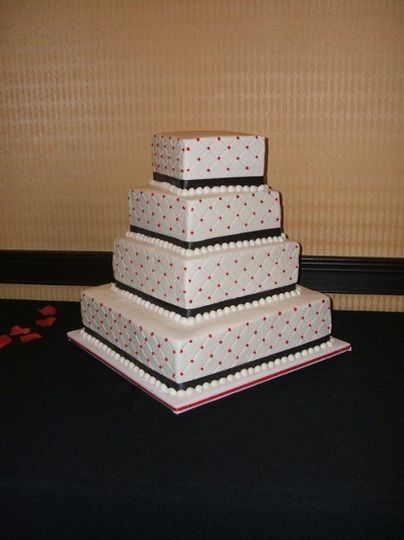 A fun buttercream cake with diamond pattern.