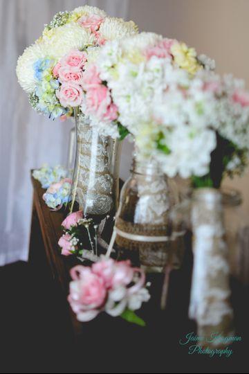 Roses, hydrangea, football mums, stock, carnations, baby's breathe, burlap & lace