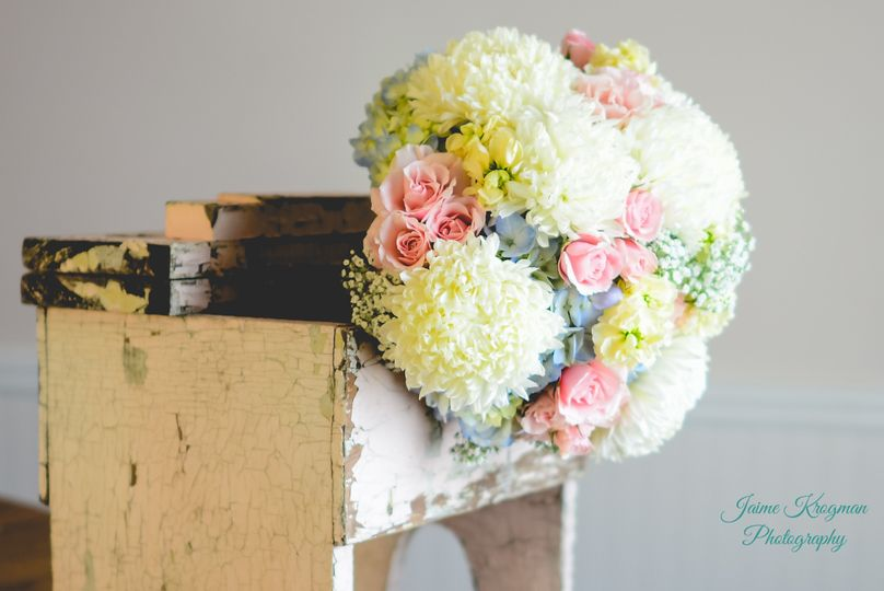 Roses, hydrangea, football mums, stock, carnations, baby's breathe, burlap & lace