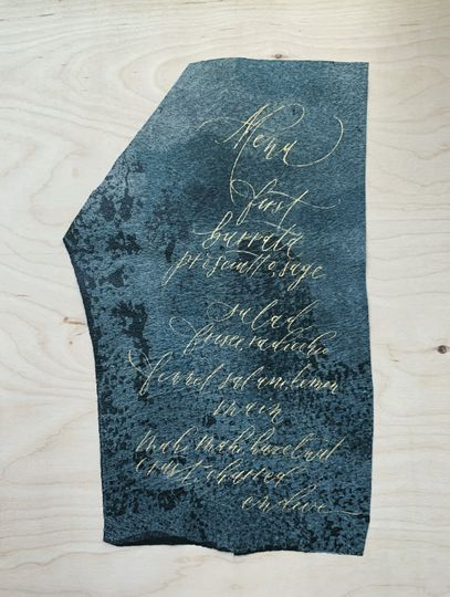 Menu-pointed pen on leather