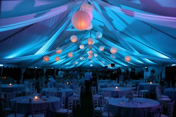 Fabric draped from the ceiling, accented by lighting set the tone for this reception. Ball lanterns...