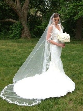 Ivan is wearing a Pronovias Diango gown with a Malis Henderson veil, Erica Koesler headpiece, Maria...