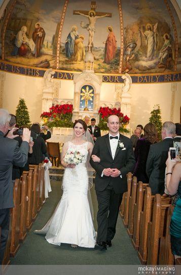 Bridget wearing an Essence of Australia wedding gown nd Erica Koesler veil.