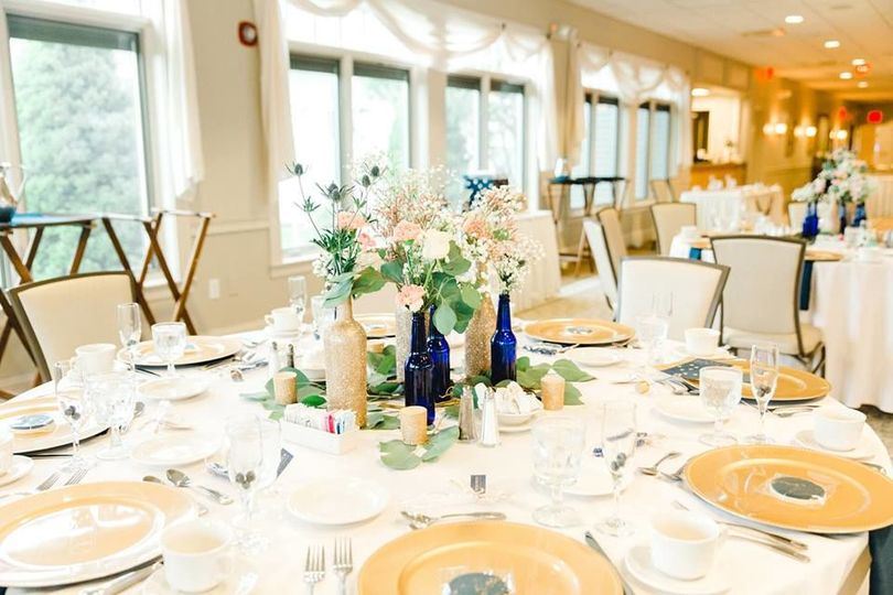 Light and airy centerpieces for our Celestial Twilight Wedding featuring gold-glittered wine bottles...