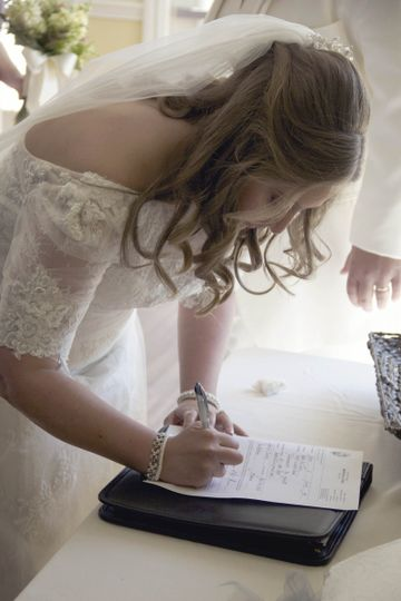 Bride signing the contract