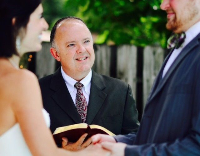 The happy officiant